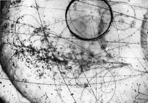 A grayscale picture consisting of curvy lines and circles that show neutrino interaction in the Fermilab 15-foot Bubble Chamber with heavy neonhydrogen liquid mixture, taken in April, 1976.